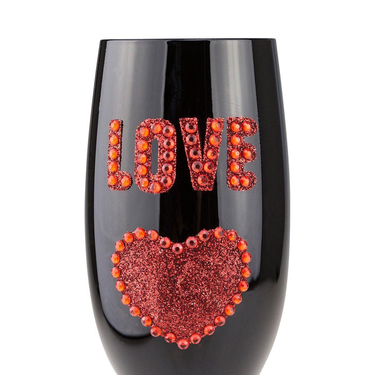 Schwarzes Sektglas mit Gravur und Liebesglitter